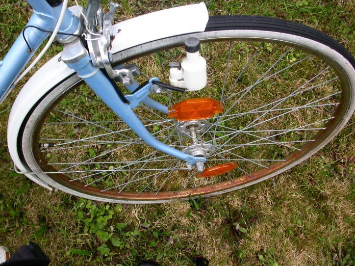 White mudguard, white sidewall tyre, and patina