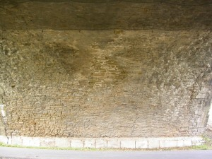 Under the bridge. No Stonemason's mark, no coat of arms, no graffiti, no nothing - just stones. Very nice.